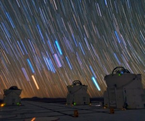This image was taken by Babak A. Tafreshi, one of ESO's Photo Ambassadors, at ESO's Paranal Observatory. It shows three of the four Auxiliary Telescopes (ATs) of the Very Large Telescope Interferometer (VLTI). Above them, the long bright stripes are star trails, each one marking the apparent path of a single star across the dark night sky, due to the rotation of the Earth. This technique also enhances the natural colours of the stars, which gives an indication of their temperature, ranging from about 1000 degrees Celsius for the reddest stars to a few tens of thousands of degrees Celsius for the hottest, which appear blue. The sky in this remote and high location in Chile is extremely clear and there is no light pollution, offering us this amazing light show.