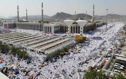 Muslim pilgrims pray outside Namira mosque in Arafat near Mecca, Saudi Arabia, Monday, Nov. 15, 2010. The annual Islamic pilgrimage draws 2,5 million visitors each year, making it the largest yearly gathering of people in the world.(AP Photo/Hassan Ammar)